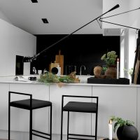 BAR STOOLS AND AUTUMN FLOWERS IN THE KITCHEN